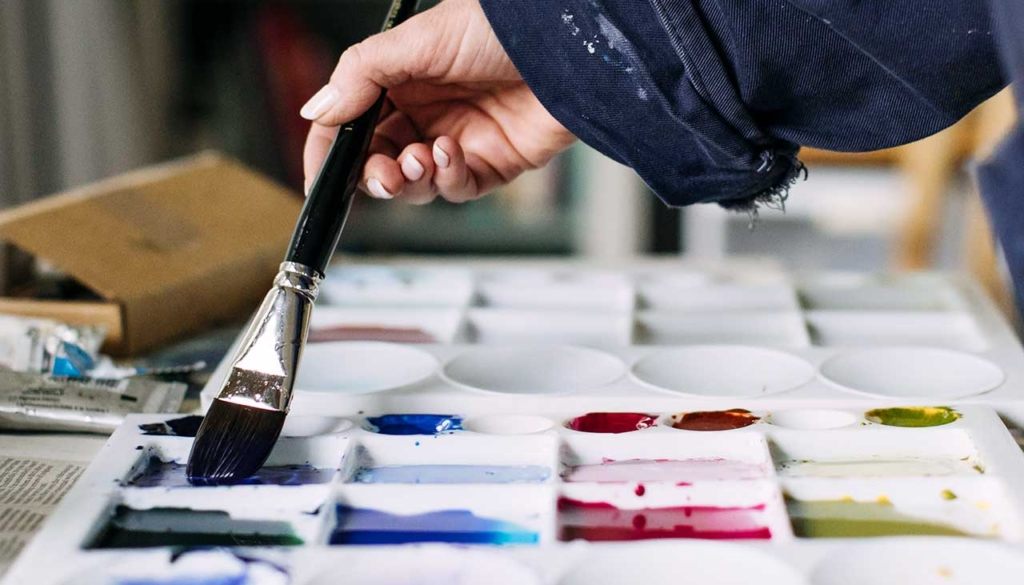 Marnie Watson at work mixing colours