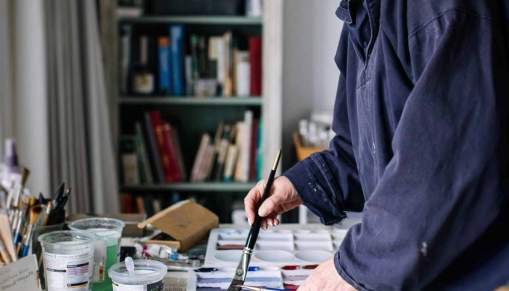 Marnie Watson painting in her Chiltern's studio
